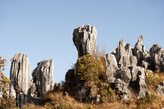 White grey colored tall standing rocks on a hill. White grey colored tall standing rocks on a hill, China Stock Image