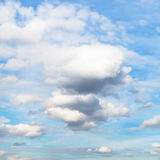 White and grey cumulus clouds in blue autumn sky Royalty Free Stock Image