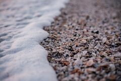 White and Grey Pebbles Near Sea Shore Stock Photo