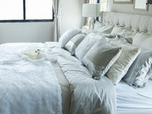 White and grey pillow on bed Royalty Free Stock Image