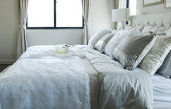 White and grey pillow on bed Royalty Free Stock Photo