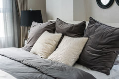 White and grey pillows on bed. In modern bedroom Royalty Free Stock Photography