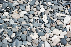 White and grey rounded stones. Background Stock Images