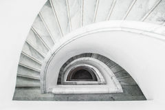 White grey spiral staircase with railing, top view.  Stock Images
