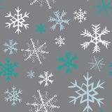 White, grey and turquoise snowflakes seamless pattern. Vector illustration on grey background. Hand drawn white, grey and turquoise snowflakes seamless pattern vector illustration