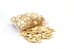 White ground large pumpkin seeds, Royalty Free Stock Image
