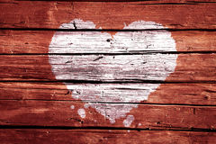 White Grunge Splashes Heart. On Red Wooden Planks Background stock photos