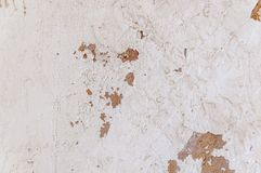 White grunge texture facade with red and yellow paint and rough. Structure stock photo