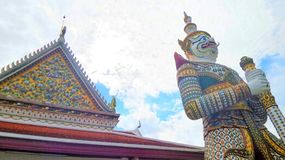 White guardian giant at Wat Arun Temple of dawn Royalty Free Stock Image