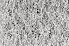 White guipure fabric with ornament. Royalty Free Stock Images