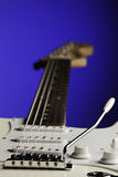 White Guitar Isolated On Blue Royalty Free Stock Photos