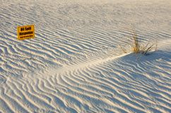White gulf coast sand and BP cleanup sign Royalty Free Stock Photos
