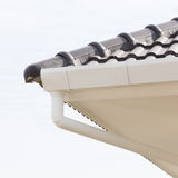 White gutter on the roof top Stock Photo