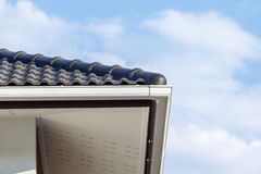 White gutter on the roof top of house Stock Photo