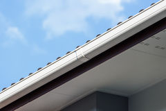 White gutter on the roof top of house Royalty Free Stock Photos