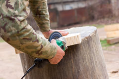 White guy handles grinder wooden detail Stock Photo