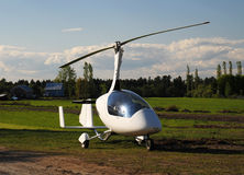 White gyroplane parked on the private airfield Royalty Free Stock Photos