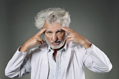 White hair scientist deeply focused Stock Image
