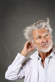 White hair scientist deeply thinking Royalty Free Stock Images