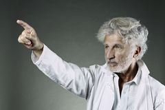 White hair scientist shows with finger Stock Photos