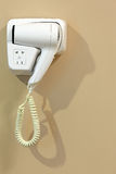 White Hairdryer on the wall Royalty Free Stock Photo