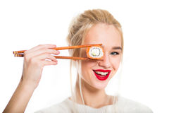 White-haired girl eating sushi Stock Photography