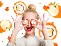 White-haired girl eating sushi Stock Photos