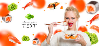White-haired girl eating sushi with a chopsticks Stock Images