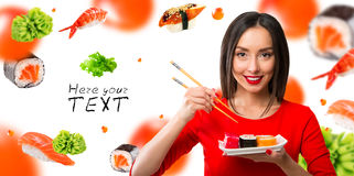 White-haired girl eating sushi with a chopsticks Stock Photography