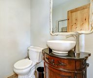 White half bath includes vintage vanity cabinet Stock Photo