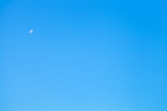 White half of moon in clear blue sky Royalty Free Stock Images