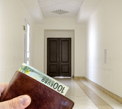White hallway with marble floor and brown door Royalty Free Stock Photos