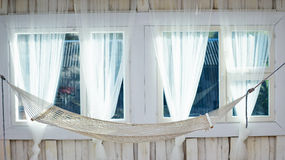 White hammock hanging near window Stock Images