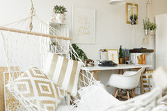 White hammock with pillows. White hammock with golden pillows in scandi room Royalty Free Stock Photo