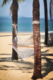 White hammock on tropical beach background. Happy summer holiday concept Stock Image