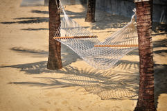 White hammock on tropical beach background. Happy summer holiday concept Royalty Free Stock Photos