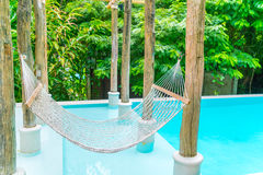 White hammocks in Luxury swimming pool . Stock Photography