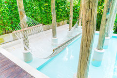 White hammocks in Luxury swimming pool . Royalty Free Stock Photography