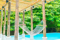 White hammocks in Luxury swimming pool . Royalty Free Stock Photos