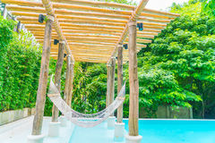 White hammocks in Luxury swimming pool . Royalty Free Stock Photo