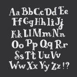 White hand-drawn letters set on dark background. Vector cartoon roman alphabet. White hand drawn letters set on dark background. Funny white abc decorated with Stock Photo