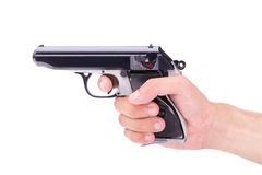 White hand holds gun  on white background Royalty Free Stock Image