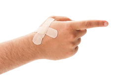 White hand with plaster pointing Stock Photography