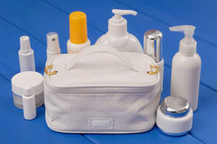 A white handbag and cosmetic preparations stock photo
