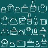 White handbags on the turquoise background Royalty Free Stock Photo