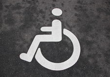 White Handicap Disabled Sign on Black Asphalt Royalty Free Stock Photography