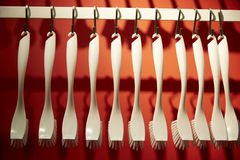 White handing brushes in red background, for sale Stock Image