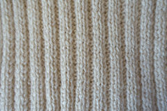 White handmade knitted fabric with vertical wales Royalty Free Stock Images