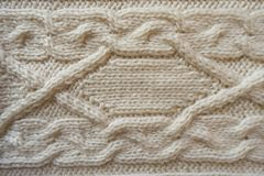 White handmade knitwork with horizontal braid pattern. From above Royalty Free Stock Photo
