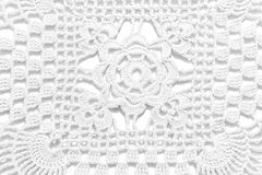 White handmade lace tablecloth texture on white background Stock Image